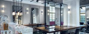 Nowoczesny salon fryzjerski w zabytkowym budynku. Wnętrza projektu studia JT Grupa