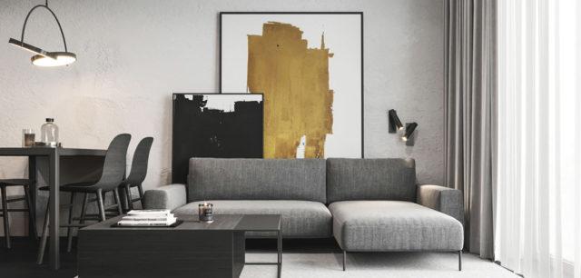 Ciemne grafity i złote dodatki – efektowne wnętrza kawalerki projektu HATCH Studio