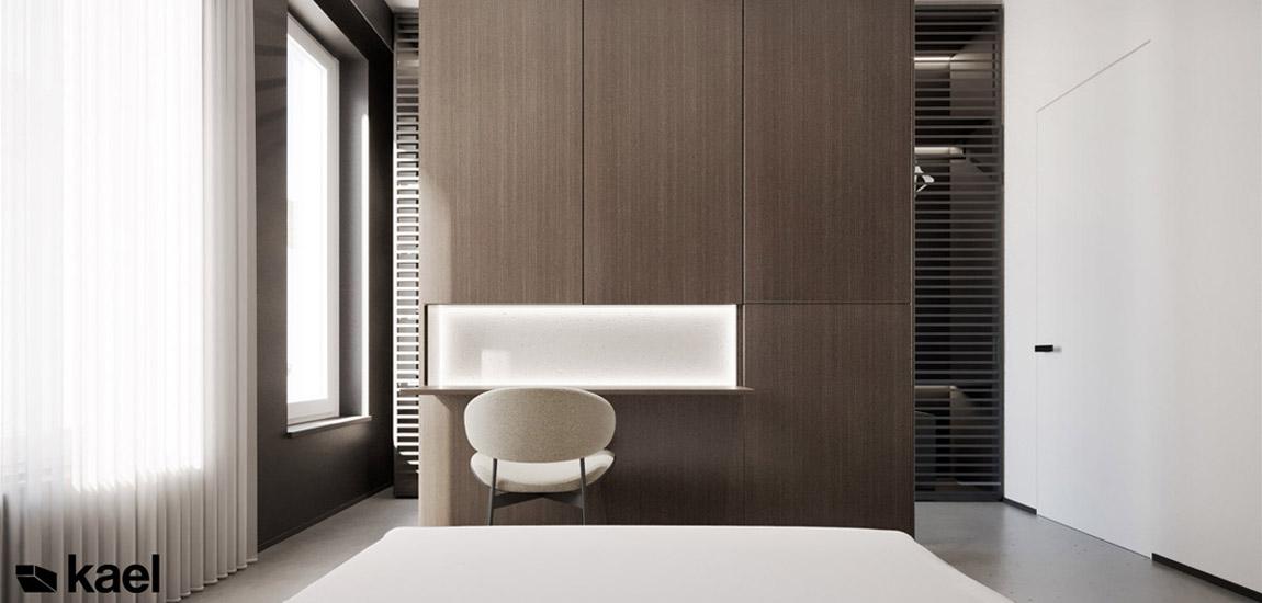 Stonowane kolory i proste, wyraziste formy. Eleganckie mieszkanie projektu KAEL Architekci
