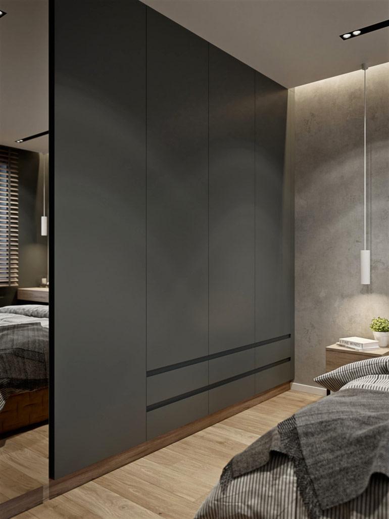 Ciemne wnętrza przełamane kolorowymi dodatkami w mieszkaniu projektu Spacja Studio