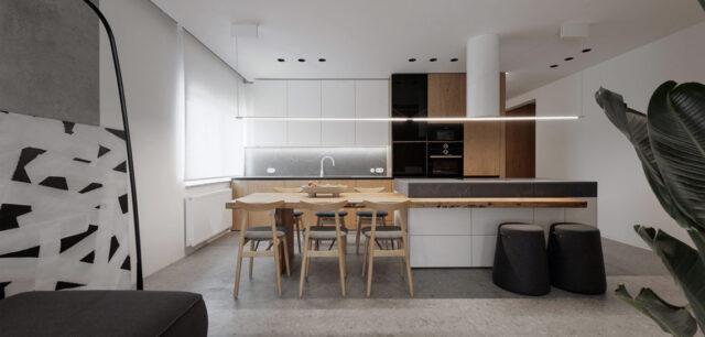 Surowe szarości i ciepłe drewno w idealnej symbiozie. Apartament projektu studia hilight.design