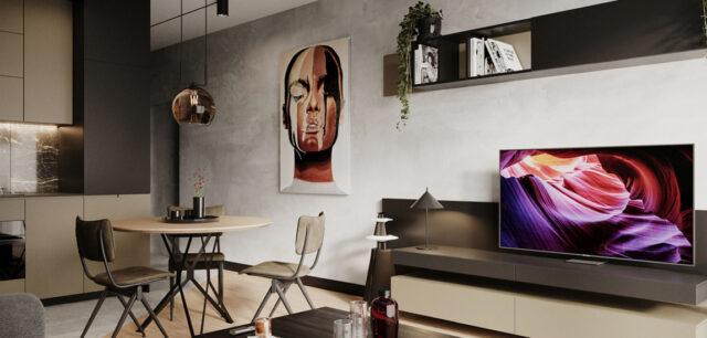 Nowoczesne mieszkanie dla singla. Ciemne barwy i naturalne materiały