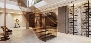 Kamienna ściana, niebanalne formy i światowy design we wnętrzach portugalskiej willi projektu hilight.design