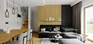 Prostota i skąpane w naturalnym świetle drewno w przytulnych wnętrzach łódzkiego domu